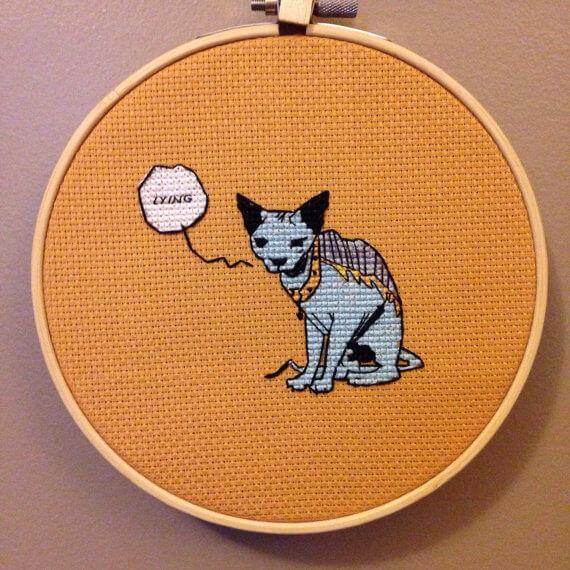 Saga Lying Cat Cross Stitch by MissStitchedCrafts (source: pinterest.com)