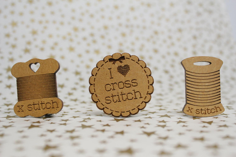 woodeb cross stitch needle minders by aneedlerunsthroughit (source: etsy)