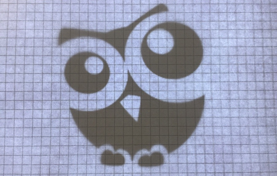 Owl image and squared paper on tracing pad